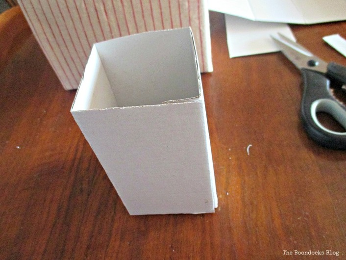 fold cardboard into box shape, untangling the wires - www.theboondocksblog.com