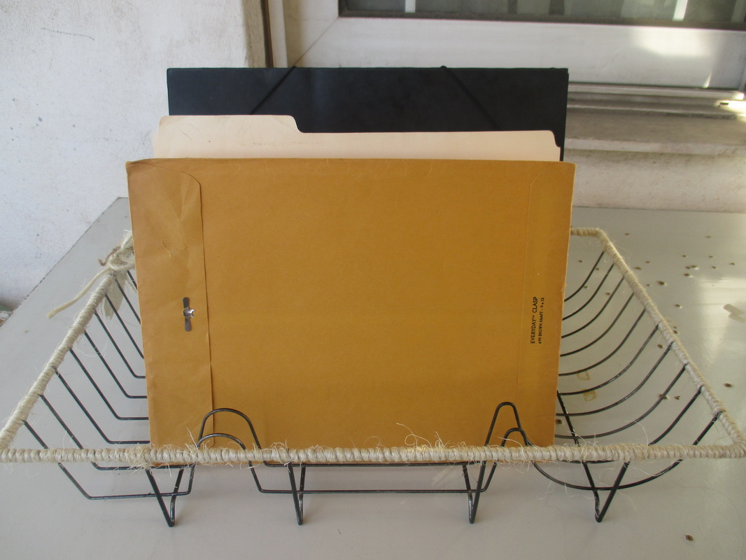 Dish rack wrapped with twine used a file holder - Wrapping up the dish rack - The boondocks blog