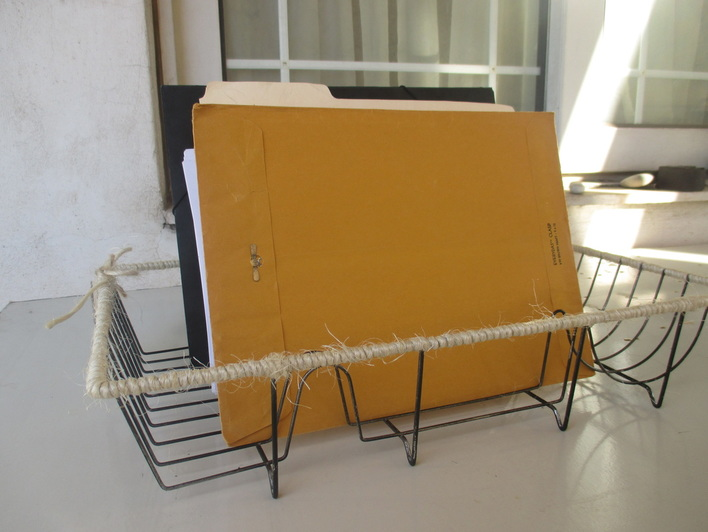 Dish rack used as file holder - Wrapping up the dish rack - the boondocks blog