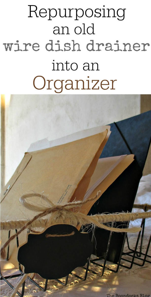 adding twine to an old dish rack and using it as an organizer Wrapping up the wire dish rack www.theboondocksblog.com #organizing #fileorganizer #repurposing #easyDIY Repurposedwiredishrack