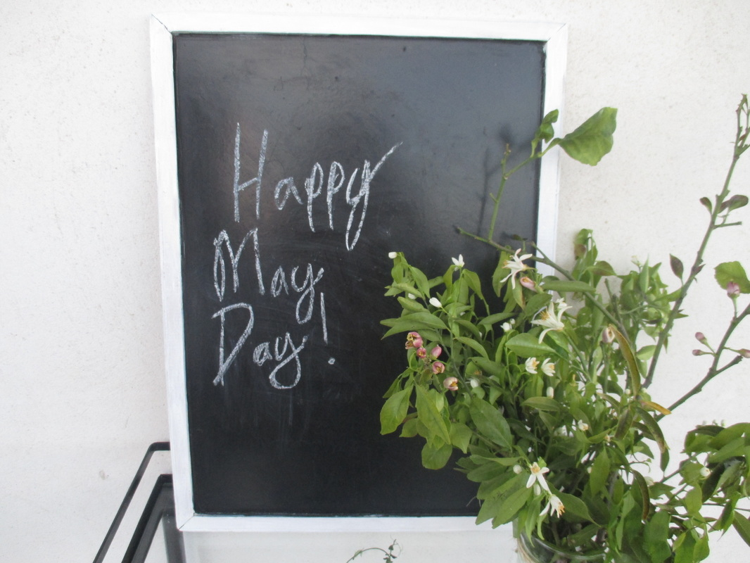 Blackboard on table with flowers, Happy May Day www.theboondocksblog.com