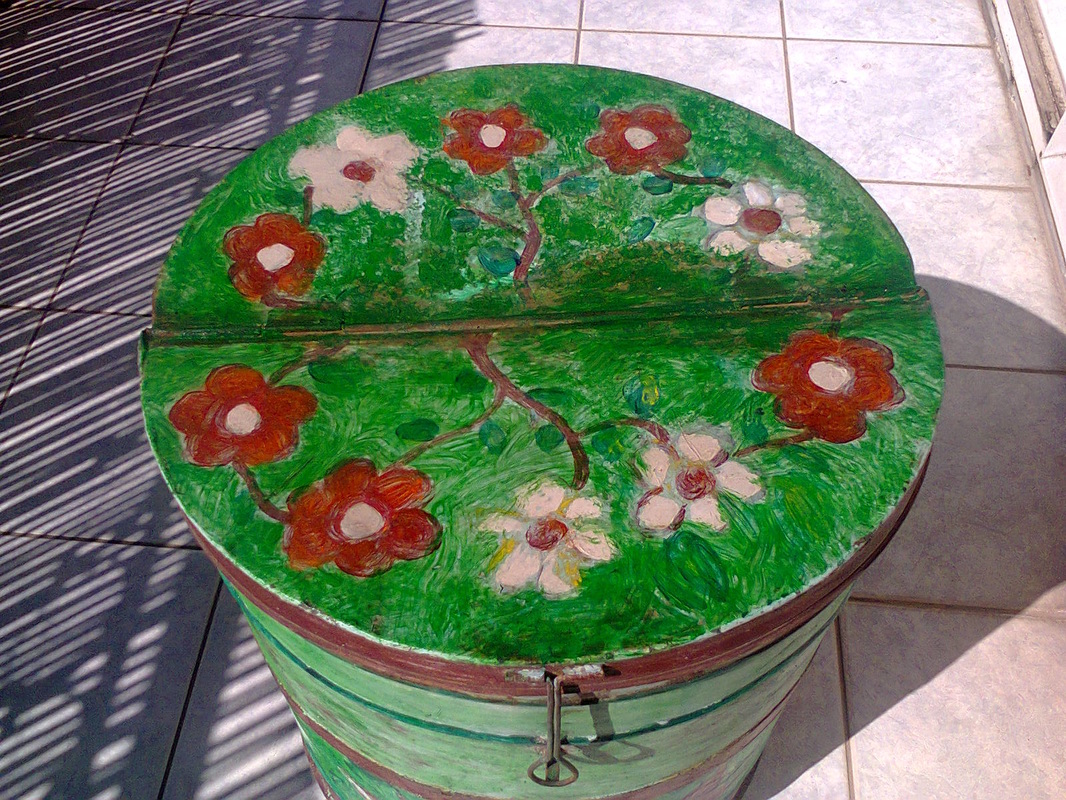 flowers on top of barrel, Revamped Olive Oil Barrels www.theboondocksblog.com
