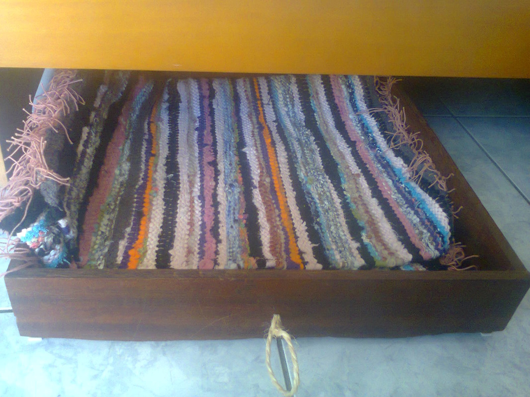 rag rugs inside,  Under the bed drawer storage, www.theboondocksblog.com