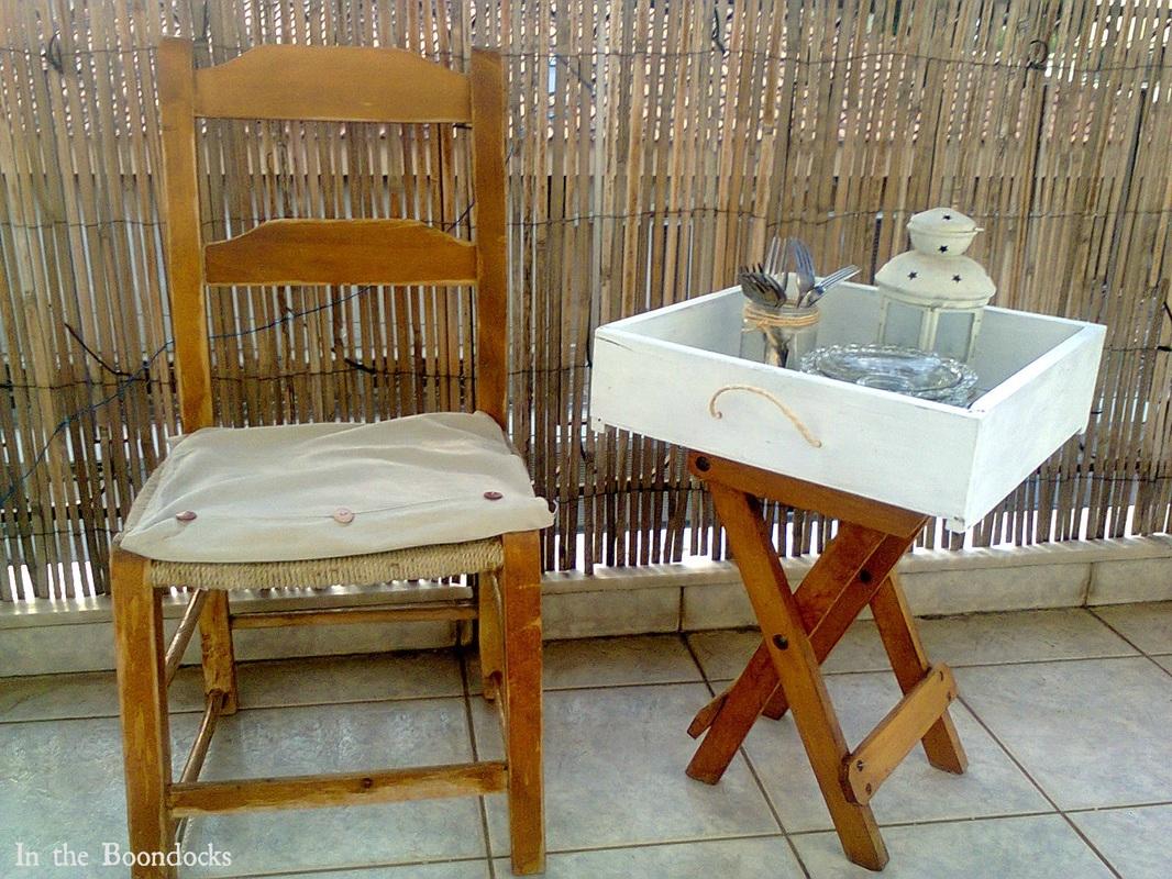 finished table next to chair, #DIYfurniture #repurposeddrawer #repurposedstool #checkerdesigntable #easyfurniture Pieces of a table, www.theboondocksblog.com