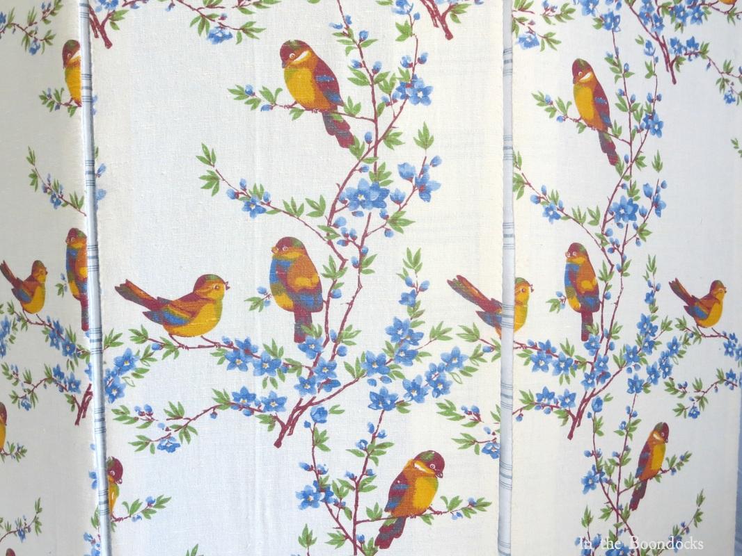 covering laminate board in batting and pretty bird fabric, Hiding the Washing Machine www.theboondocksblog.com