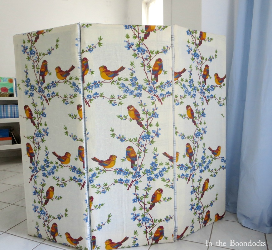 Using laminate boards to create a folding panel partition to hide the washing machine in the room, Hiding the Washing Machine www.theboondocksblog.com