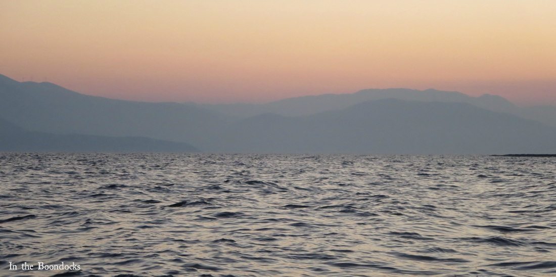 Photo essay of boat ride at sunrise, looking at the mountains against the red - Magic in the Morning www.theboondocksblog.com