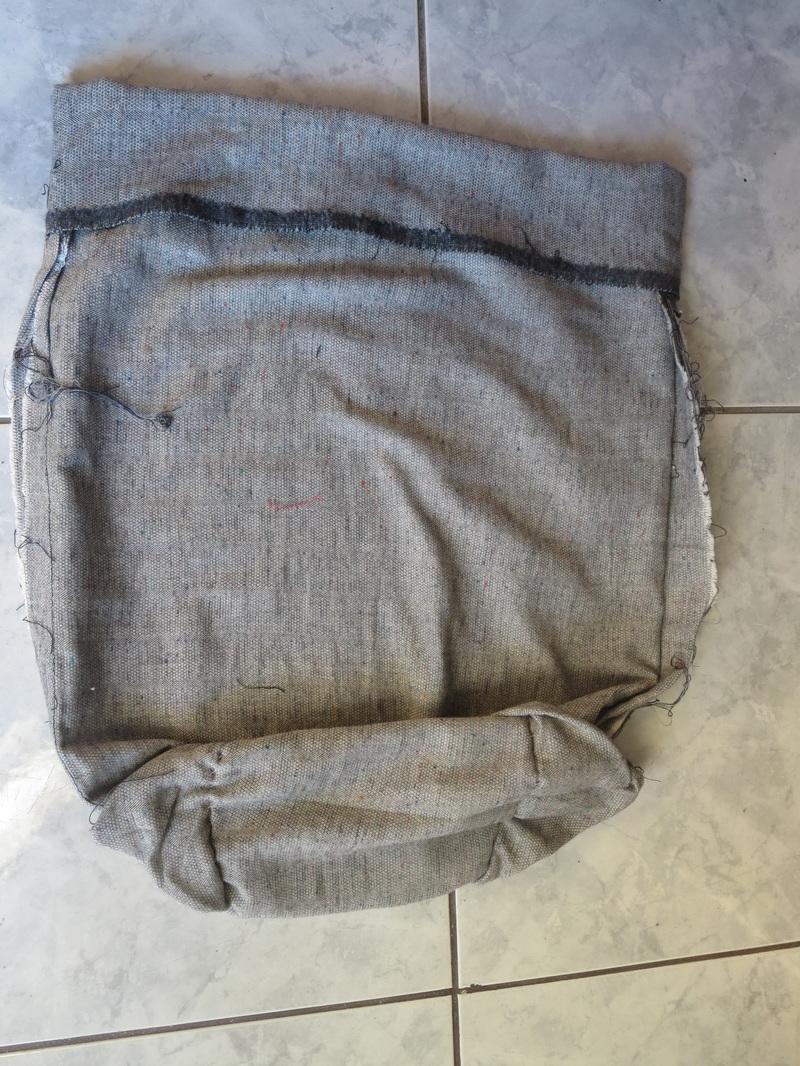 grey fabric folded into pocket, Tweety's Storage Stool www.theboondocksblog.com