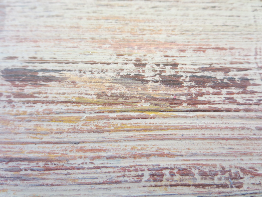 close up of the paint made to look like old wood, Seeing Red www.theboondocksblog.com
