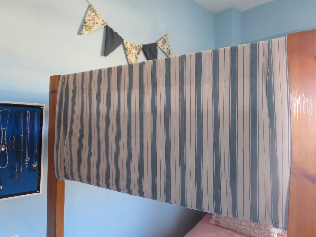 T oning down the wood by covering it with blue striped fabric, The Blue Bunk Bed www.theboondocksblog.com