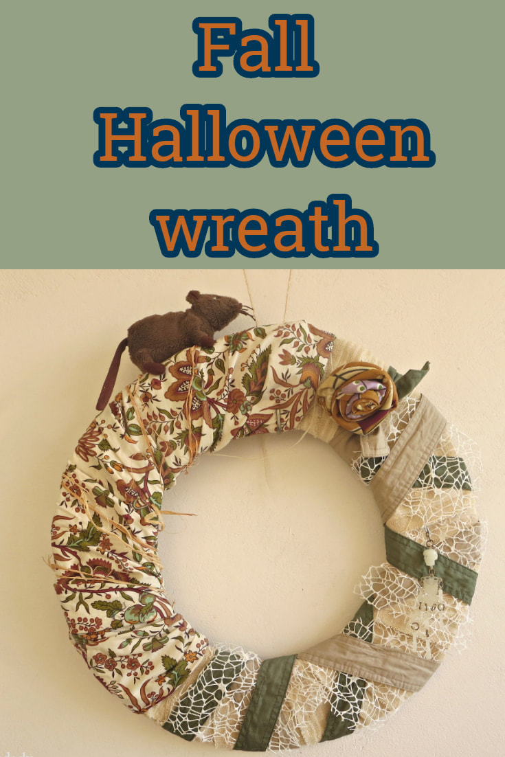 Fall Halloween wreath with scraps of fabric, #halloweenwreath #fallwreath #repurposed #upcycled #frugalwreath #seasonalwreath The schizophrenic wreath www.theboondocksblog.com