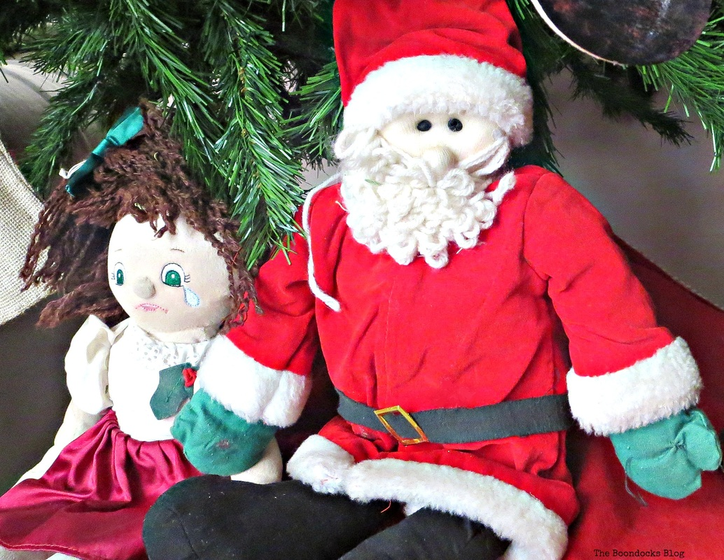 Santa doll at the foot of the Christmas tree The Inspiration for my Christmas tree - the Boondocks blog