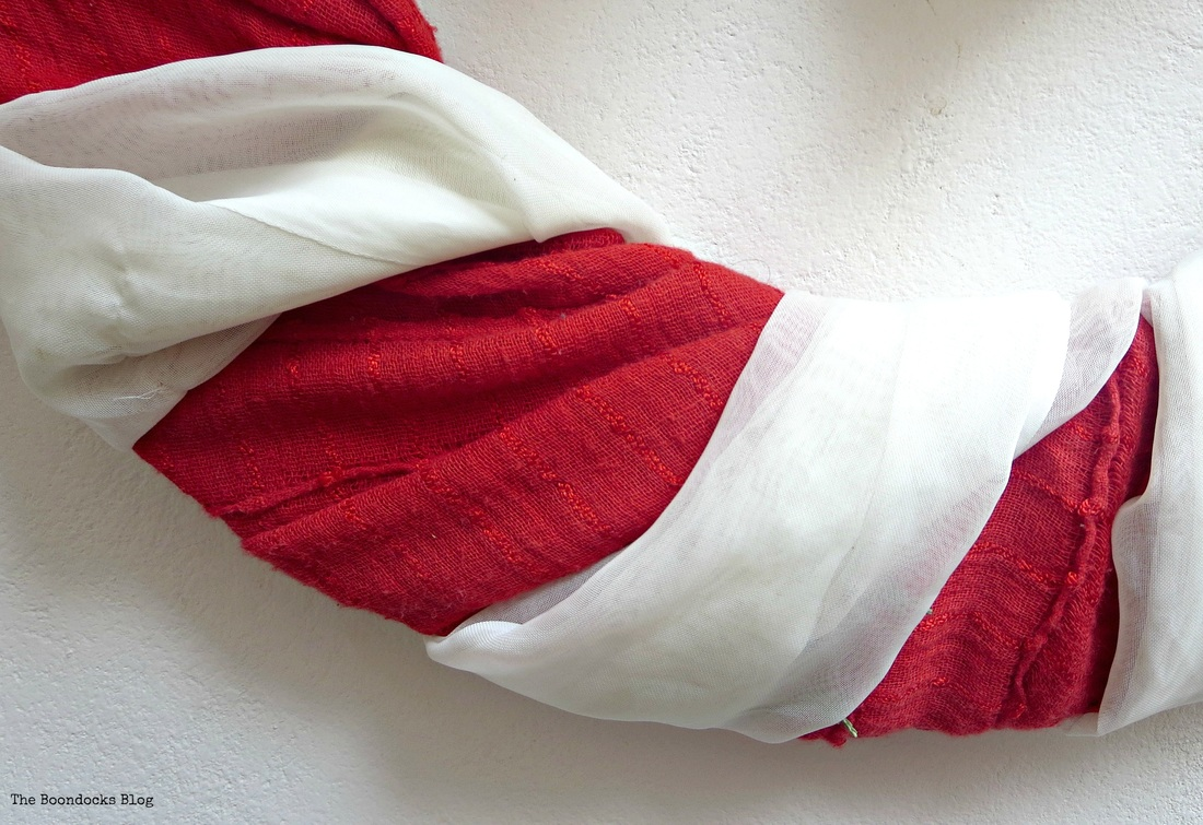 Detail of wreath, red and white strips of fabric wrapped around - the boondocks blog