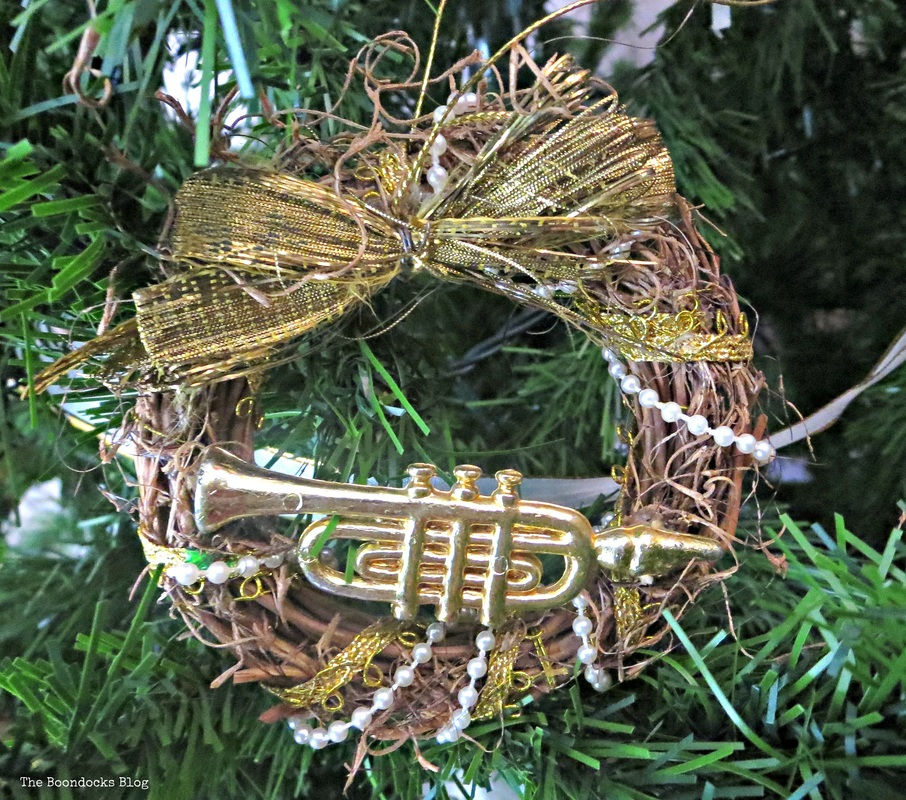 Wreath with Trumpet ornament on Christmas tree -The Inspiration for my Christmas tree the boondocks blog