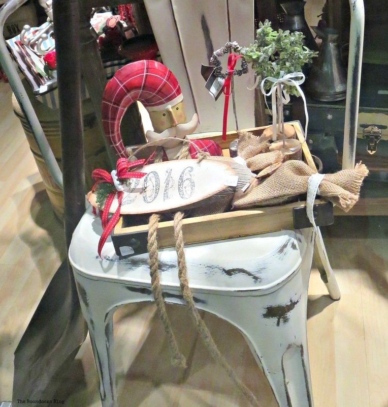 Display window with Santa on metal chair, A bright night on the town - The boondocks blog