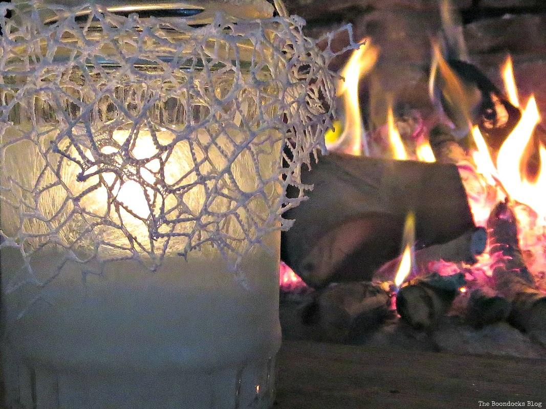 A lit tea light decorated with crystal ice spray, the snow spray that wasn't - the boondocks blog