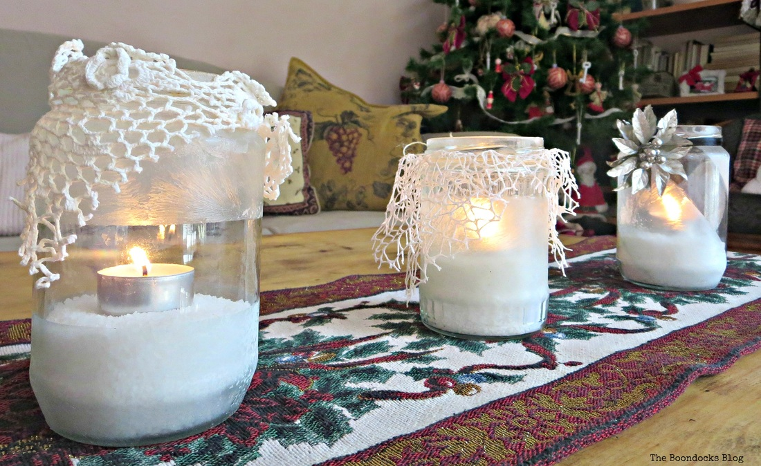 Three lit tea lights decorated with crystal ice spray and lace. the snow spray that wasn't - the boondocks blog