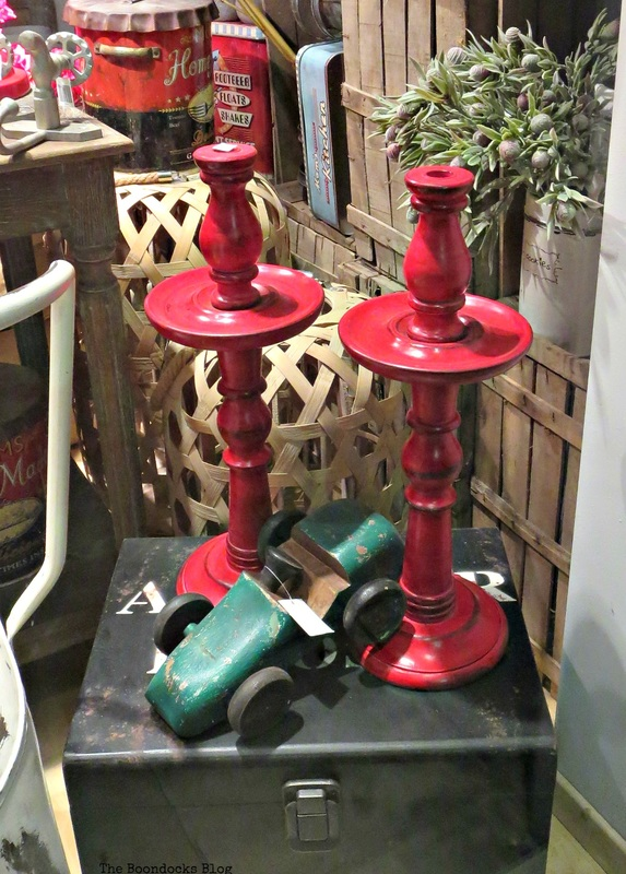 Red candleholders in window display, A bright Night on the Town - the Boondocks blog