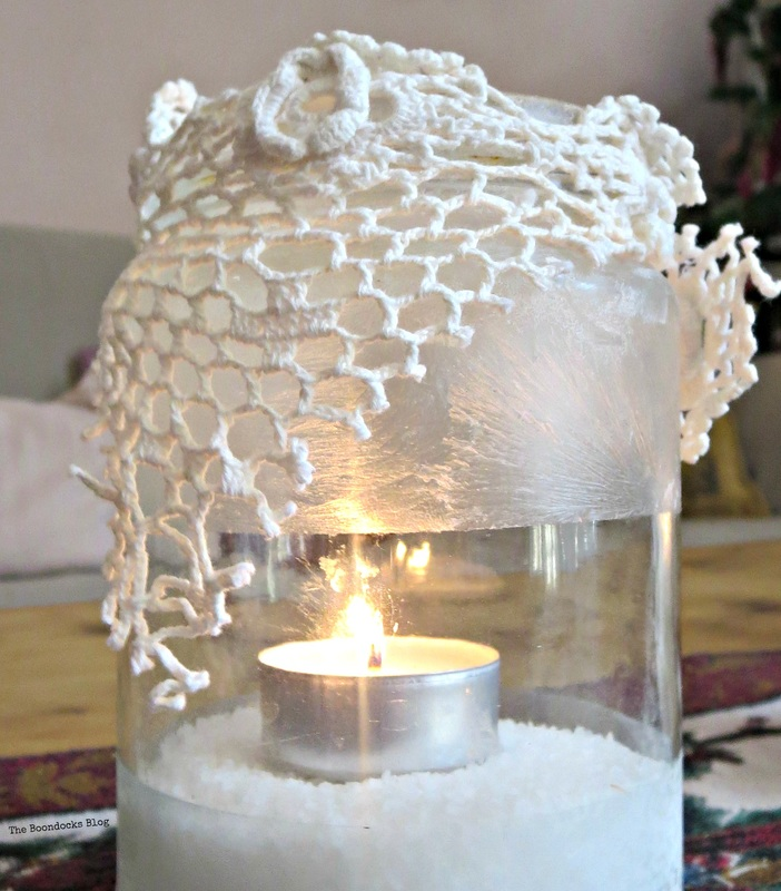 Lit tea light decorated with crochet lace and crystal ice s pray , the snow spray that wasn't - the boondocks blog