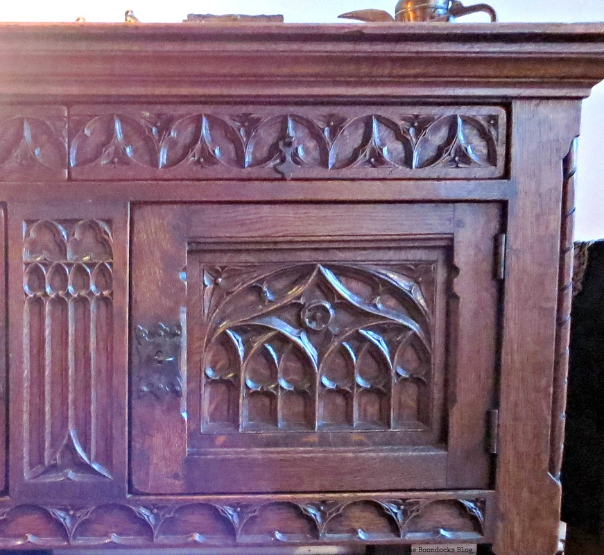 A wooden buffet table, with wood carvings, A house full of treasures - the Boondocks Blog