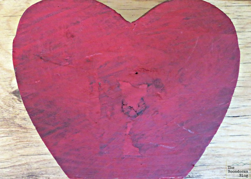 red paint on heart shaped wood, what the heart hides - the boodocksblog.com