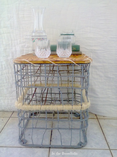 wired milk storage crate turned into a table.
