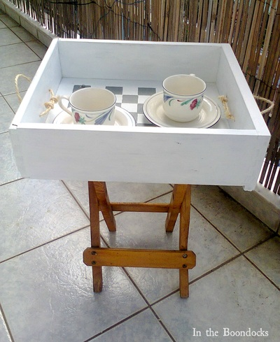 White tray added to the top of a folding table.