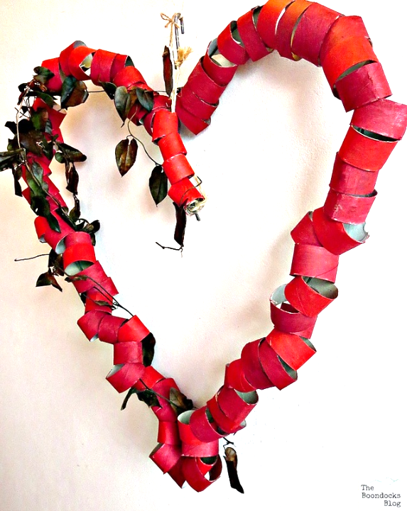 The finished heart-shaped wreath hanging on the wall.