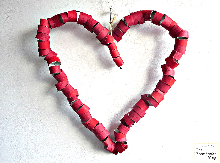Heart shaped wire covered with toilet paper roll sections painted red.