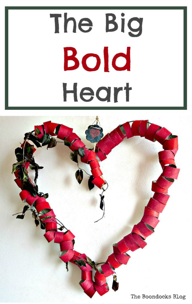 At a budget-friendly splash of red and whimsy to your Valentine's decorating with a Big, Bold Heart craft made from upcycled toilet paper rolls.