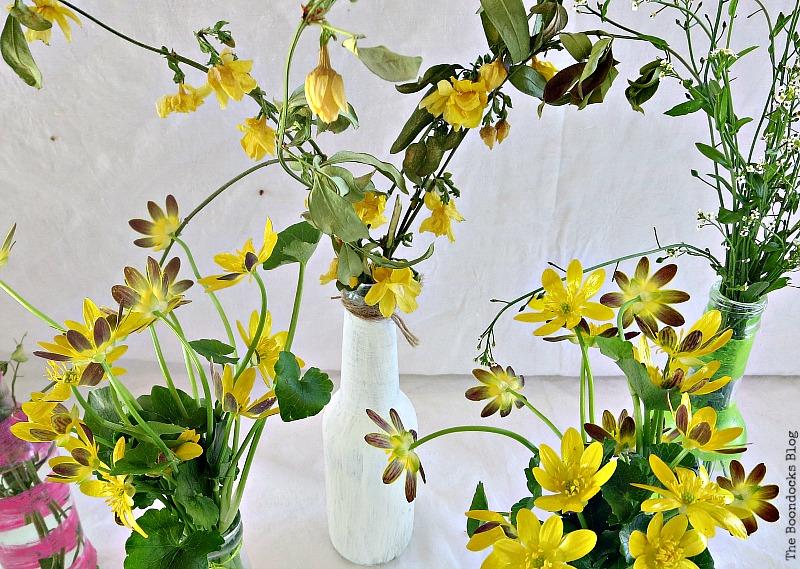 Yellow wildflowers in bottles, My Spring Roll Bottles www.theboondocksblog.com