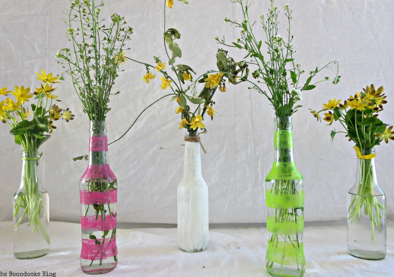 Assortment of bottles with wild flowers, My Spring Roll Bottles www.theboondocksblog.com