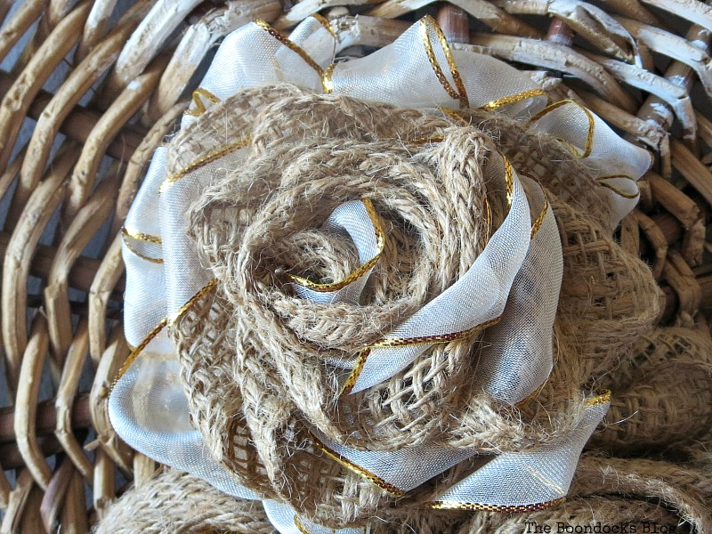 A flower made with burlap and ribbon, The Crafty Bottom www.theboondocksblog.com