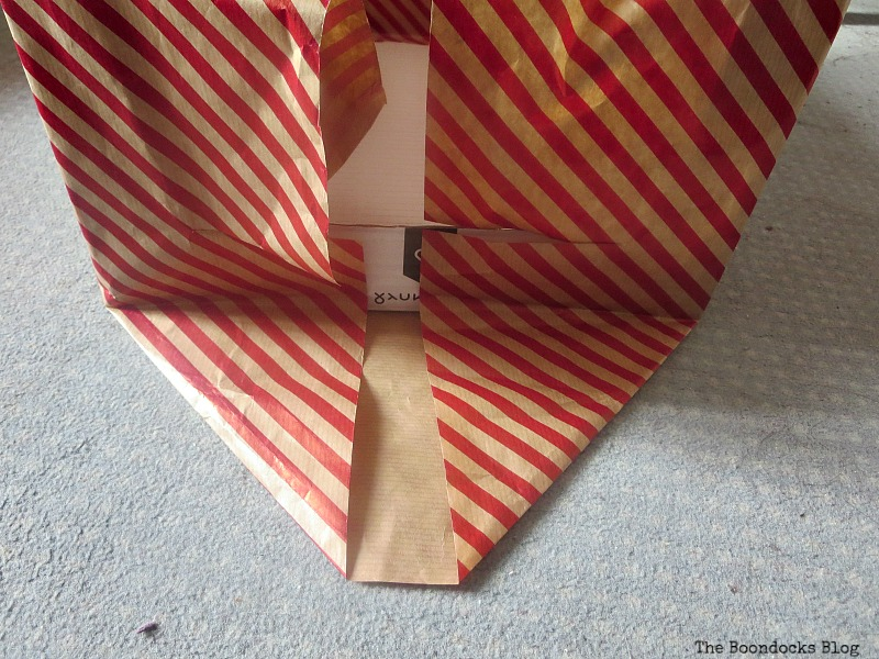 Folding paper as in gift wrap Pretty Boxes for Organizing Clothes in the Closet www.theboondocksblog.com
