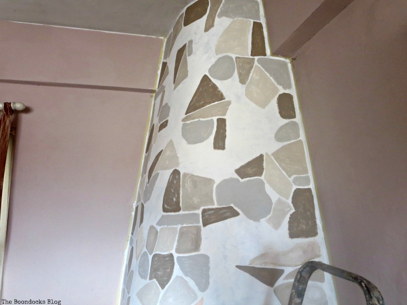 Painting the stones on the fireplace , The Long Overdue Fireplace makeover www.theboondocksblog.com