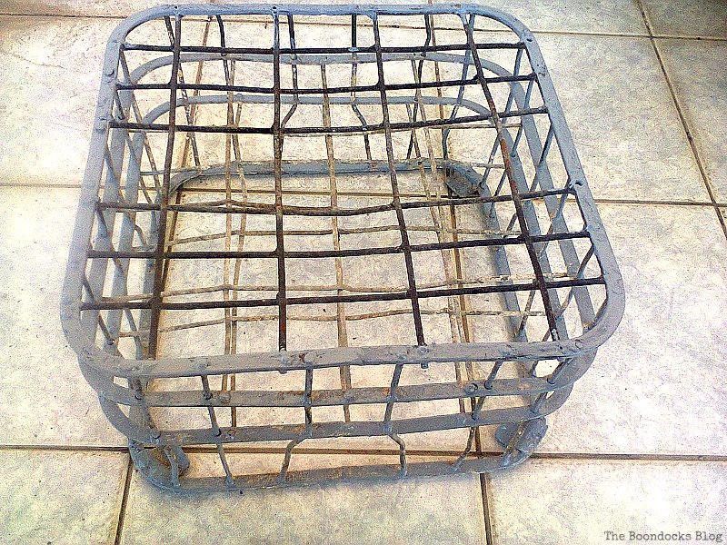 Wire milk crate with rust.