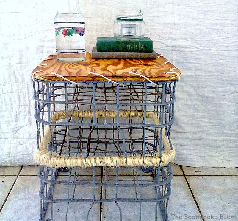 The wire milk crate table before the upcycle.