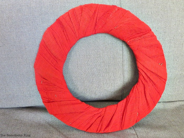 Wrappping red fabric, The lopsided Summer Wreath www.theboondocksblog.com