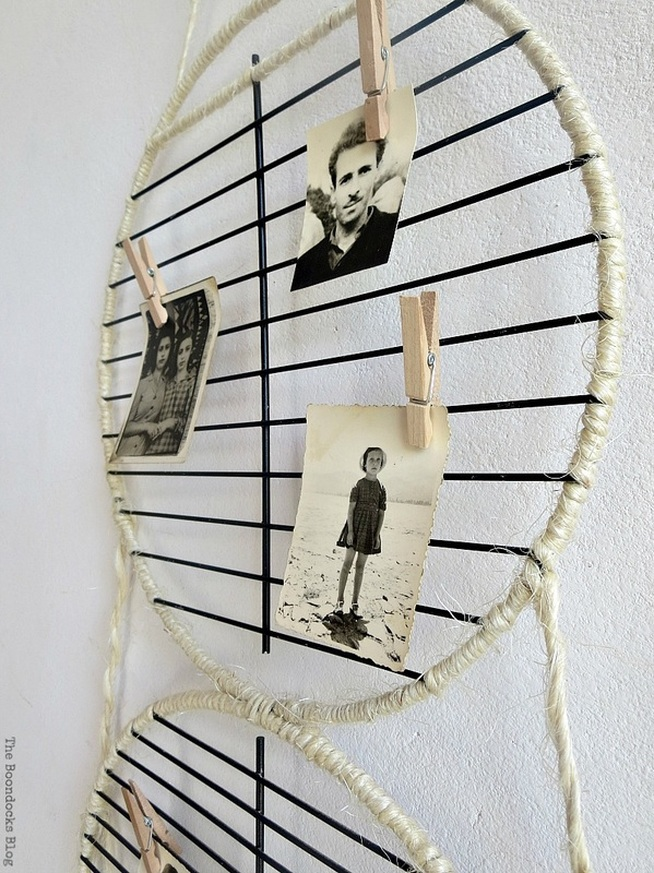 Barbecue grill rack repurposed into a photo display for Father's Day, #wallphotodisplay #photodisplay #farmhousestyle #fathersdaygift #giftidea #hangingwallidea #easycraft #simplecraft #Twine #repurposedgrillparts A Wall Photo Display for Father's Day www.theboondocksblog.com