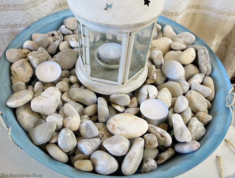 Placing tealights on top of pebbles, How to make a Nautical Lantern from a Grill - Int'l Bloggers Club Challenge www.theboondocksblog.com