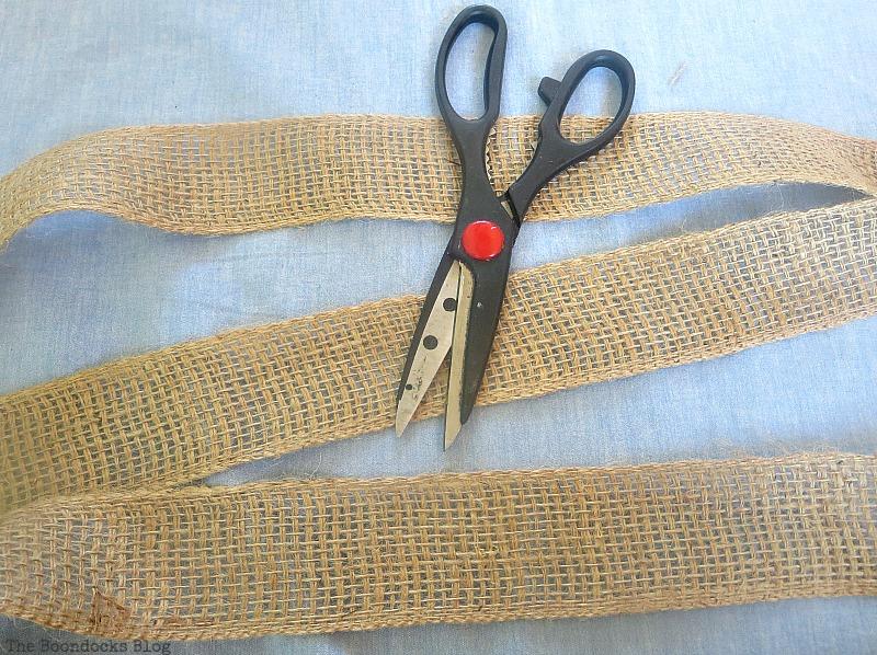 Cutting the burlap ribbon, The Virsatile Hanging Saucer / www.theboondocksblog.com