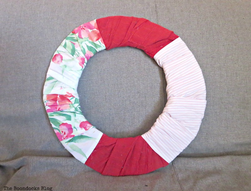 Wrapping floral and striped fabrics in certain areas, The lopsided Summer Wreath www.theboondocksblog.com