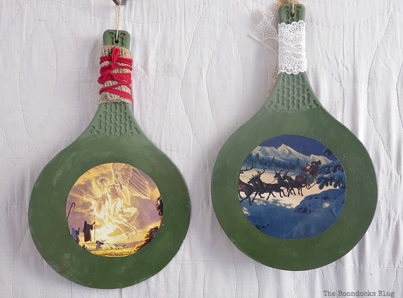 2 rackets with mod podged Christmas scenes, Christmas in July - Repurposed Barbie Paddles www.theboondocksblog.com
