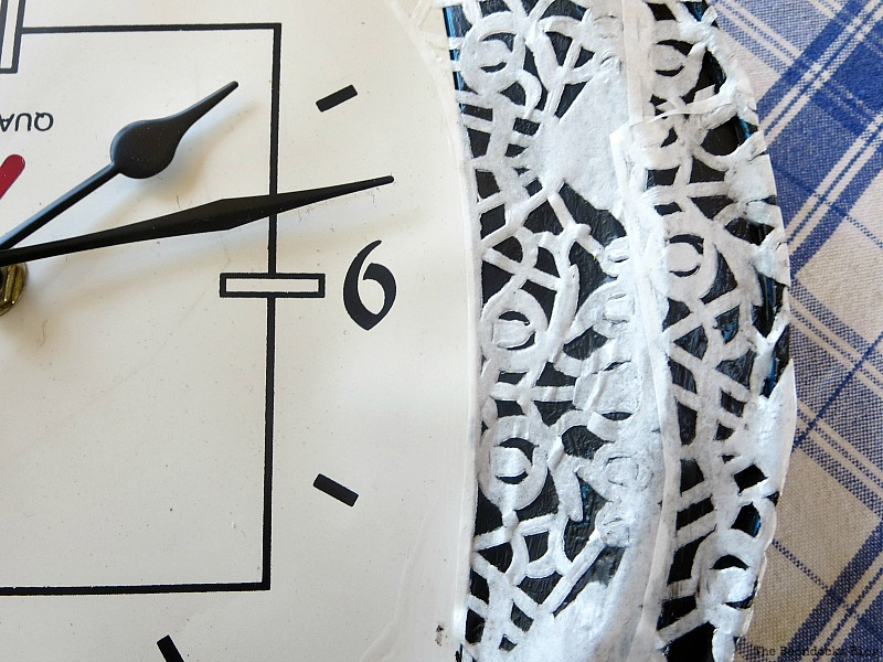 Decoupaging the doily onto the clock face, Five Minutes to a Pretty Clock www.theboondocksblog.com