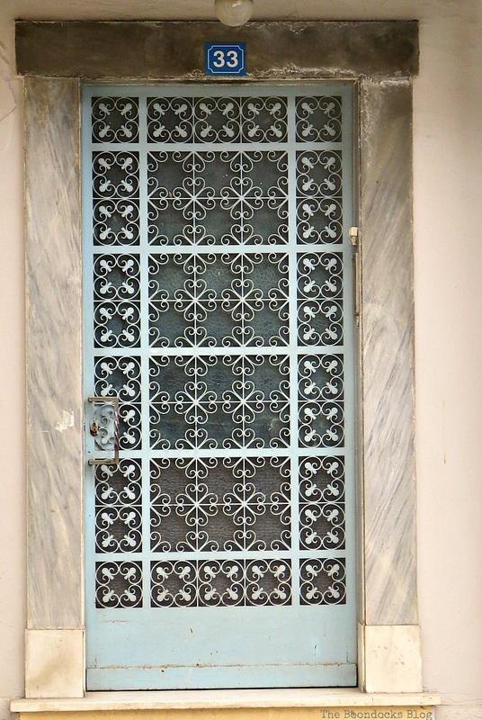 Light blue metal door, Doors and a Sorta Blogoversary www.theboondocksblog.com