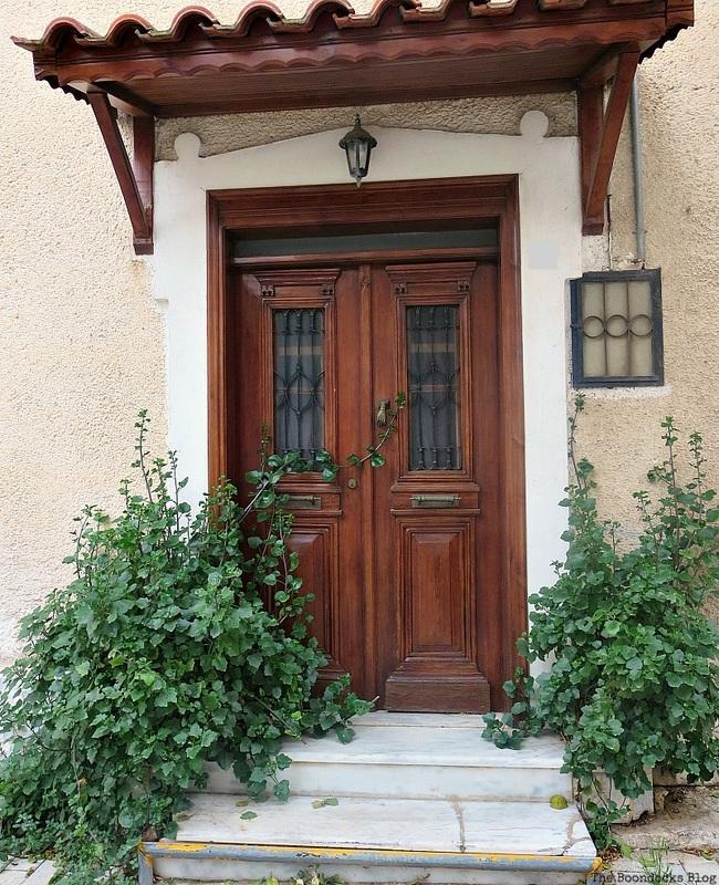 Traditional wooden door with metal on windows, photo essay on Doors and a Sorta Blogoversary www.theboondocksblog.com