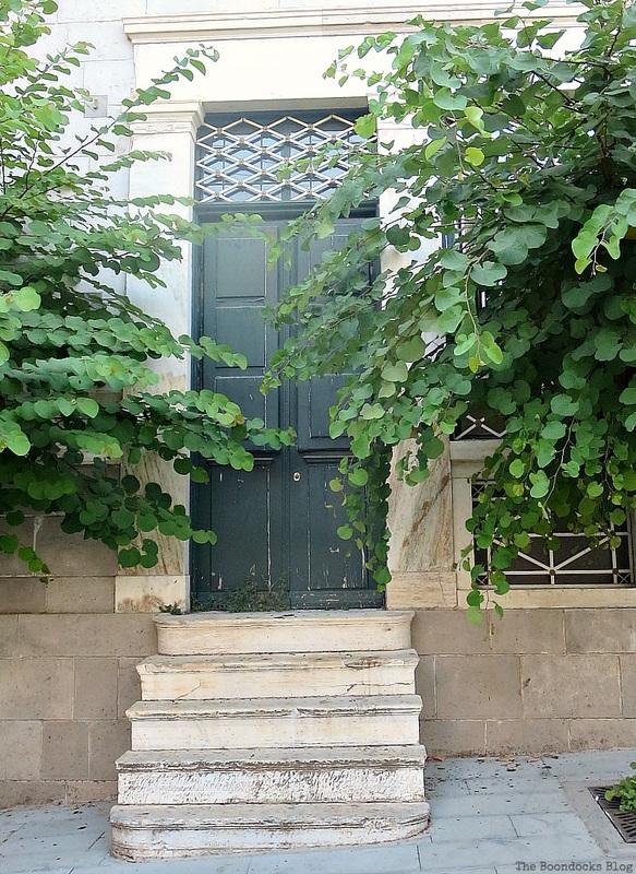 Narrow green wooden door,photo essay on Doors and a Sorta Blogoversary www.theboondocksblog.com