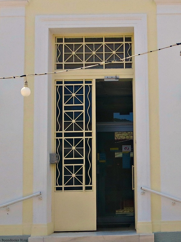 Opened yellow metal door, Doors and a Sorta Blogoversary www.theboondocksblog.com