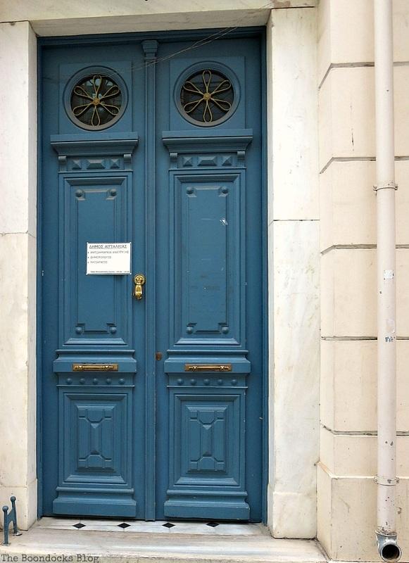 Blue door with circular windows, Doors and a Sorta Blogoversary www.theboondocksblog.com