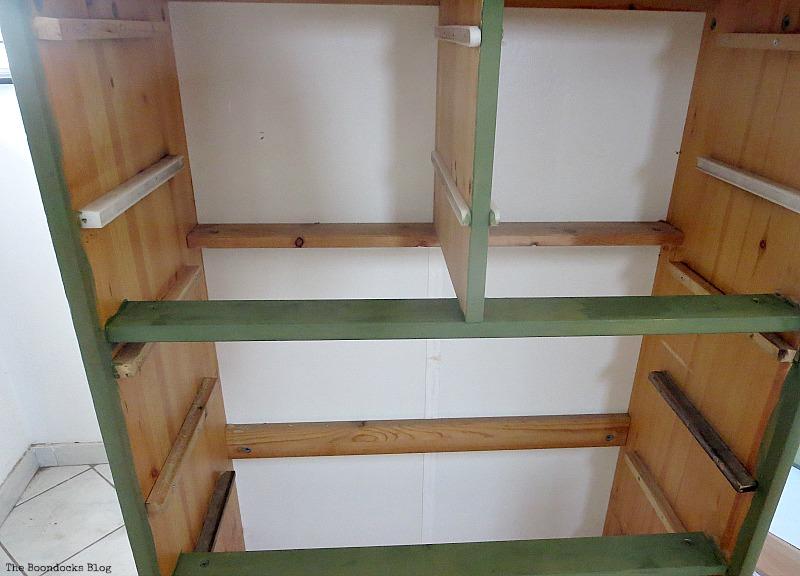 First coat of dark green paint, How to save an Ikea Pine Dresser www.theboondocksblog.com
